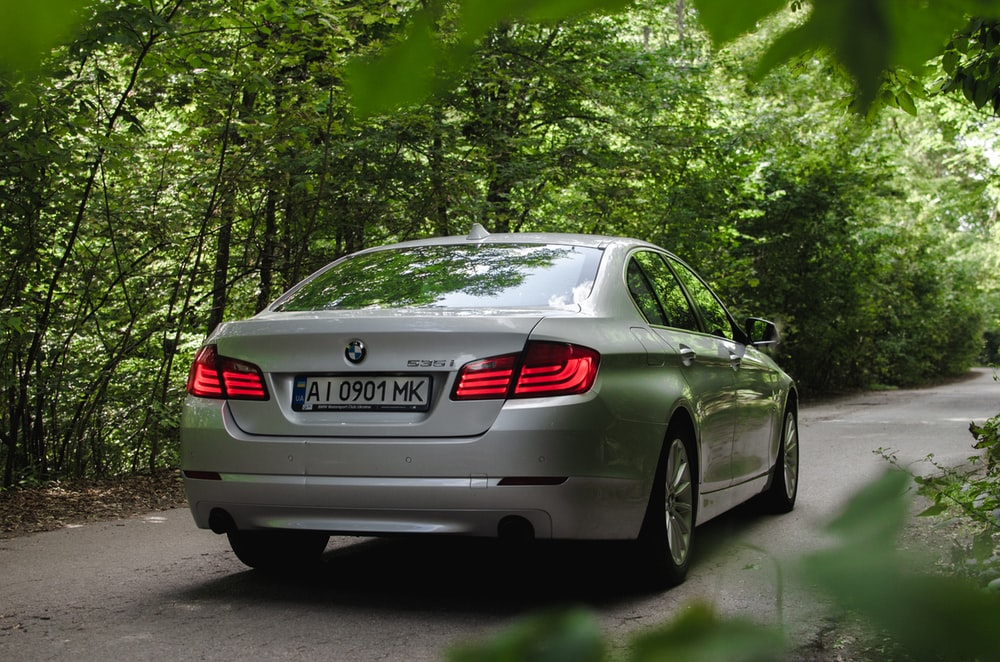 gray bmw m 3 coupe parked on gray concrete road during daytime