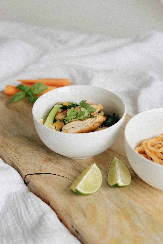 pasta with sliced lime on white ceramic bowl