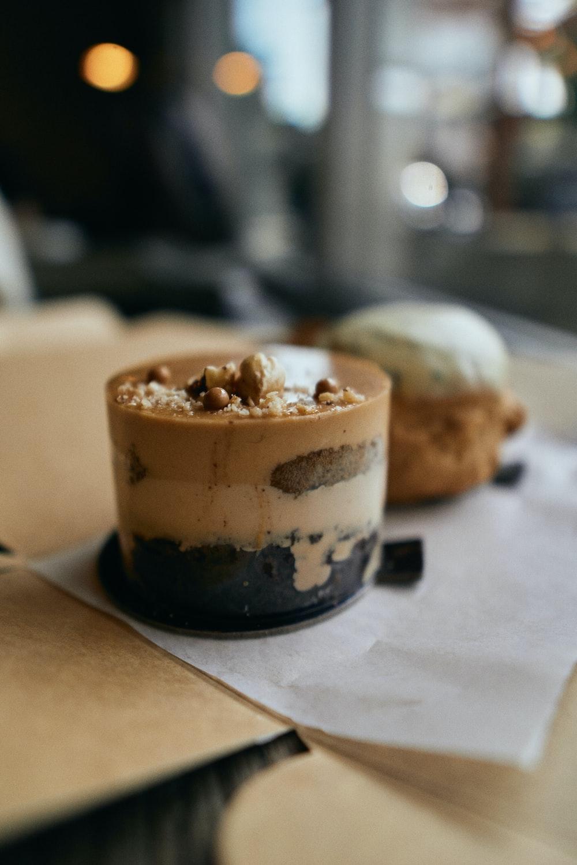 white and brown ice cream on black ceramic bowl