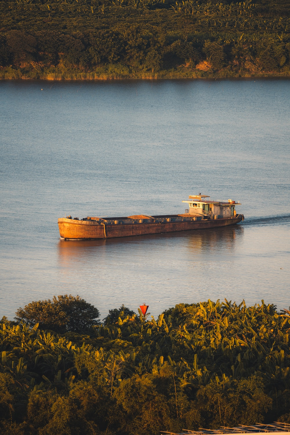 brown ship on body of water during daytime