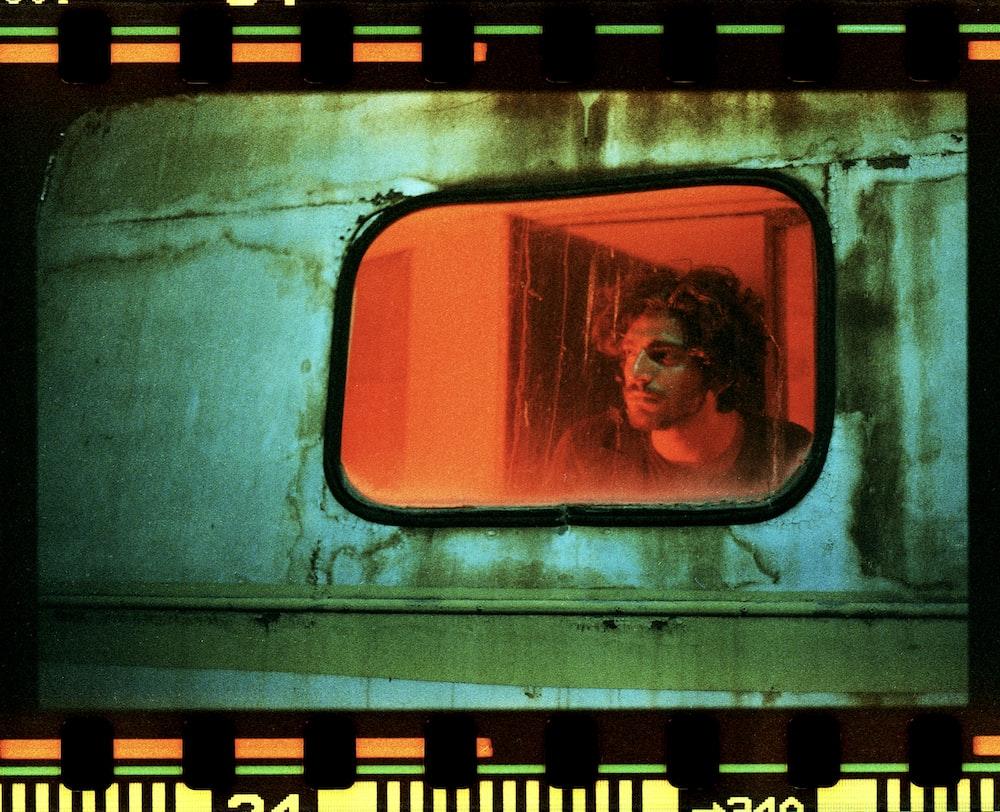 woman in orange shirt in train station