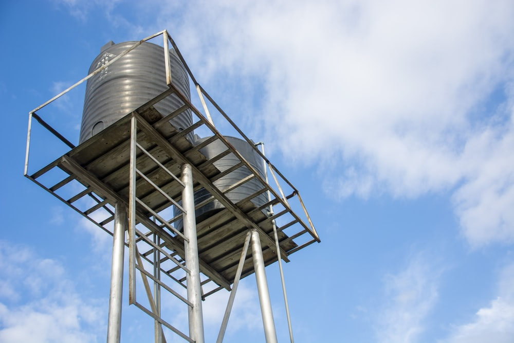 white metal tower under blue sky during daytime