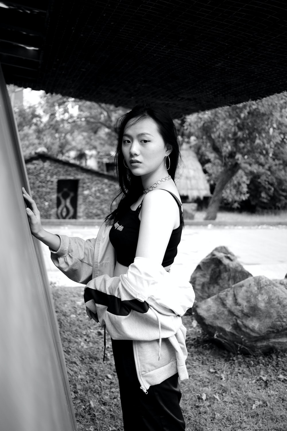 woman in white and black dress standing near body of water during daytime