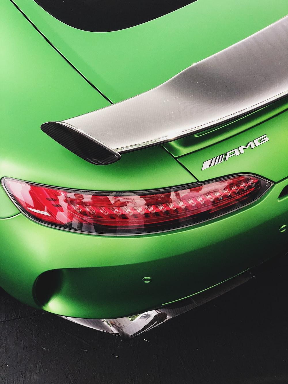 green porsche 911 parked on gray pavement
