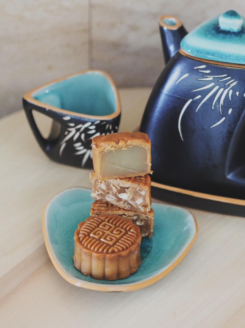 brown and blue ceramic mug on blue ceramic saucer