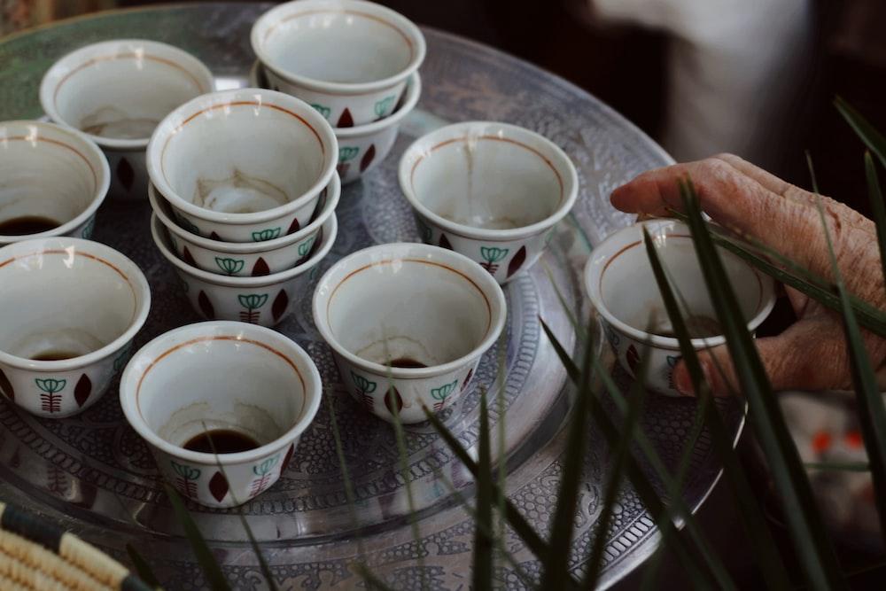 white ceramic bowls on glass table