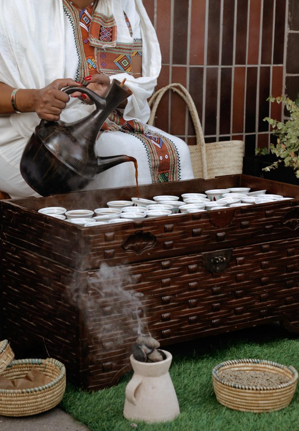 black ceramic teapot on brown woven table