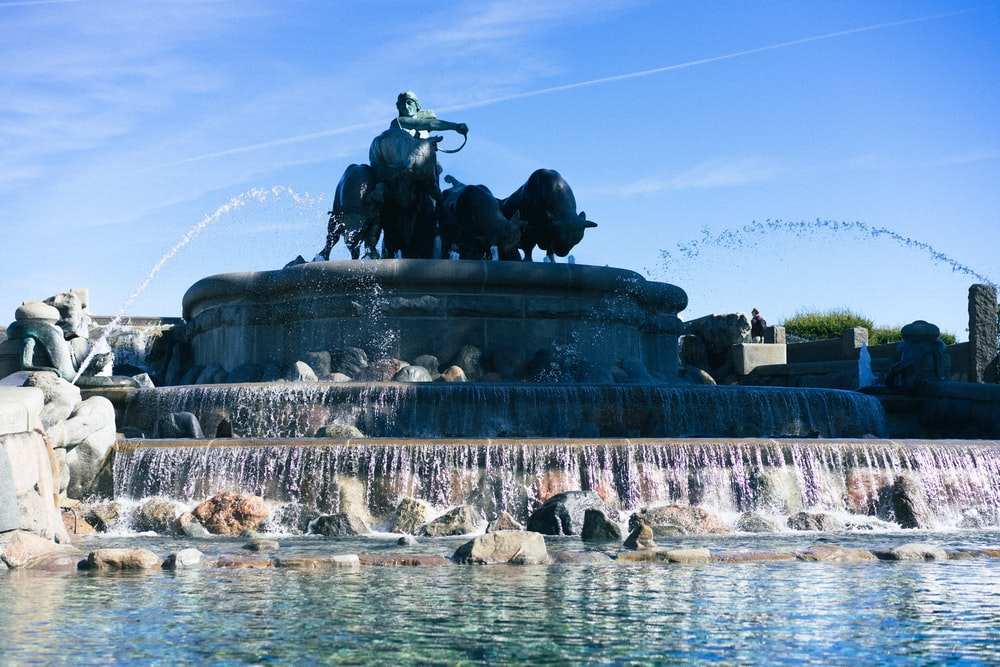 man riding horse statue on water fountain during daytime