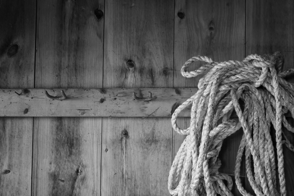 rope tied on wooden wall
