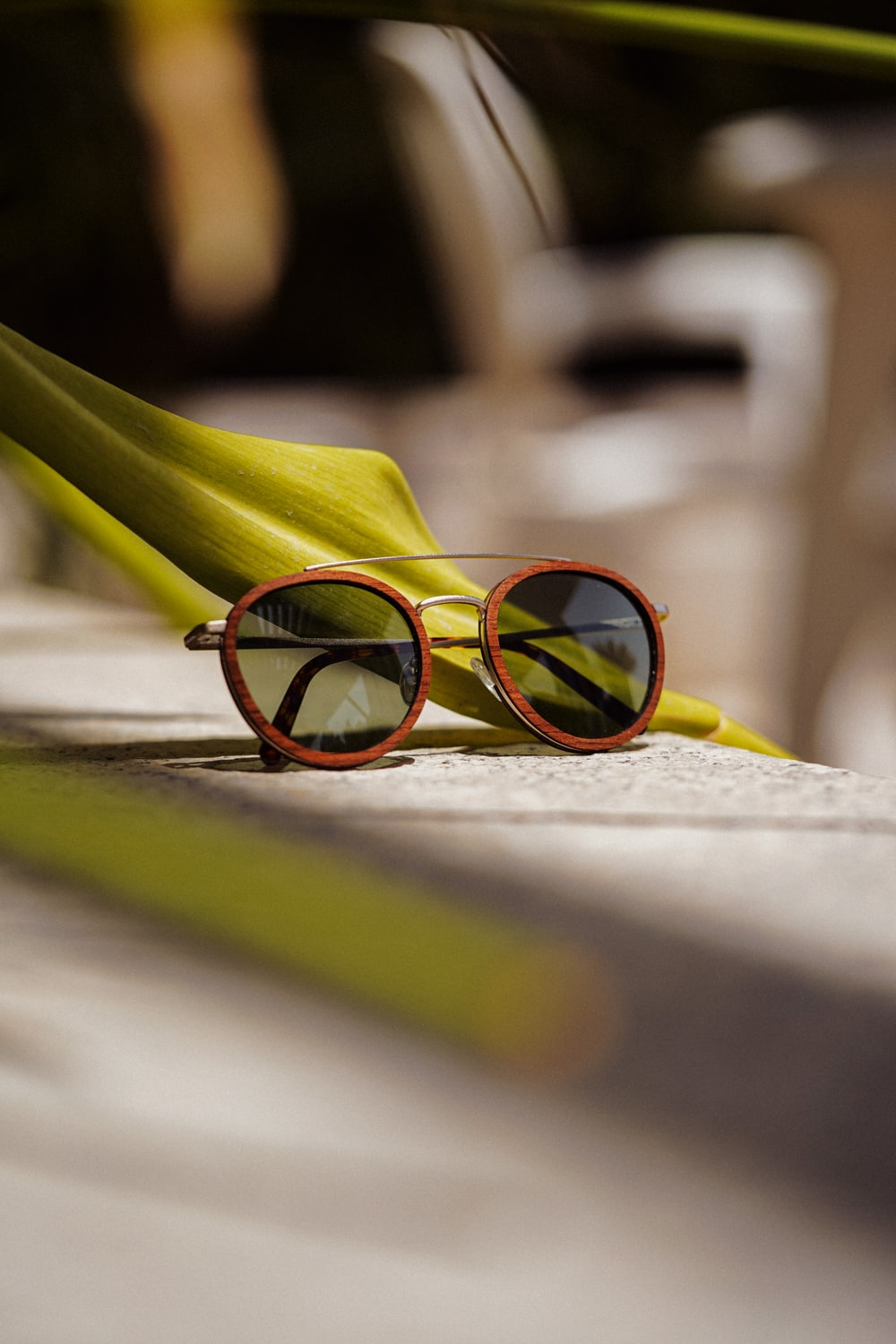 yellow framed sunglasses on white surface
