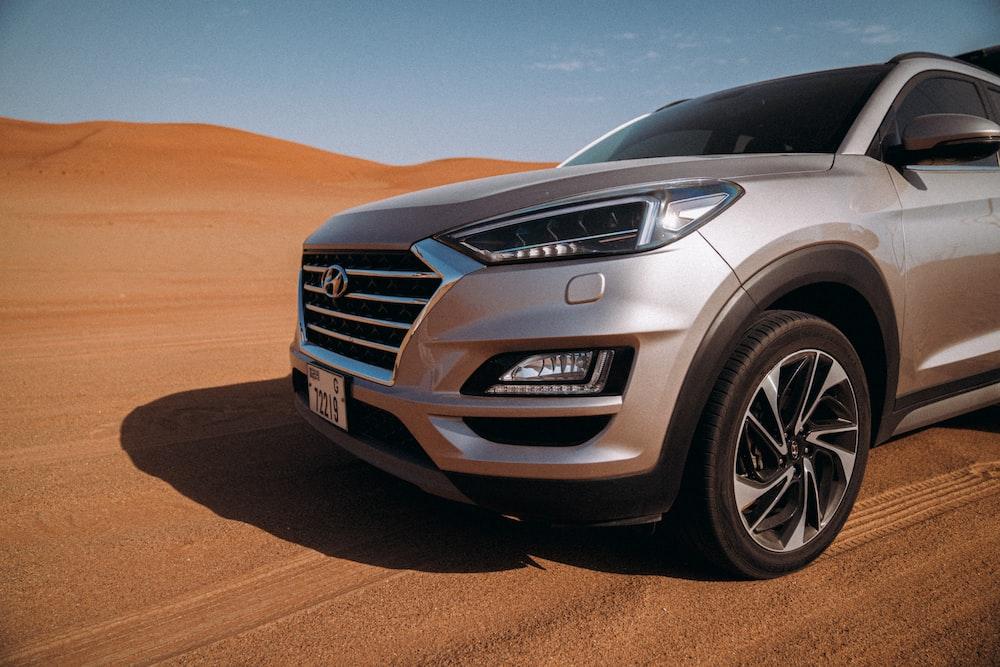 silver mercedes benz car on desert