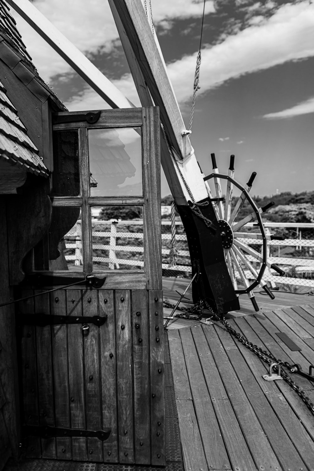 grayscale photo of a man in a wooden house