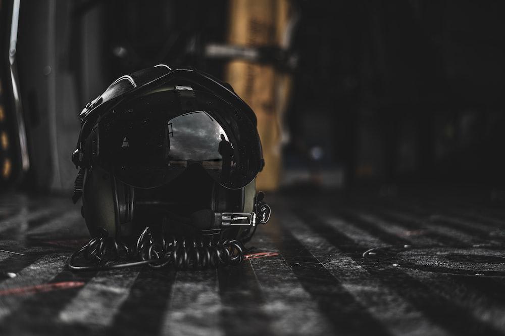 black motorcycle helmet on the floor