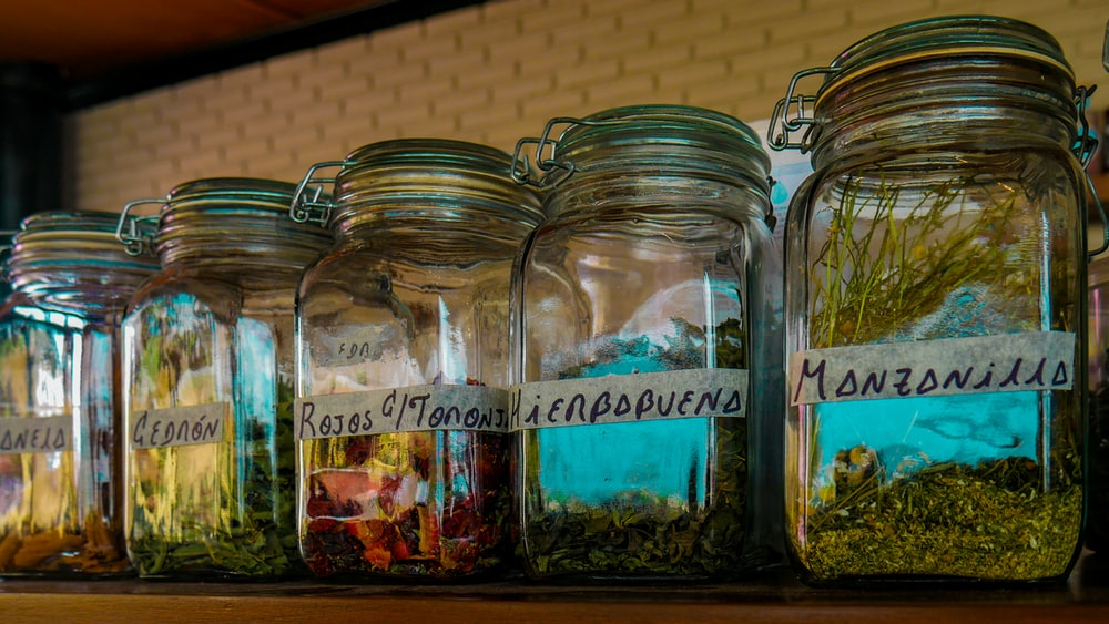clear glass jars with assorted spices