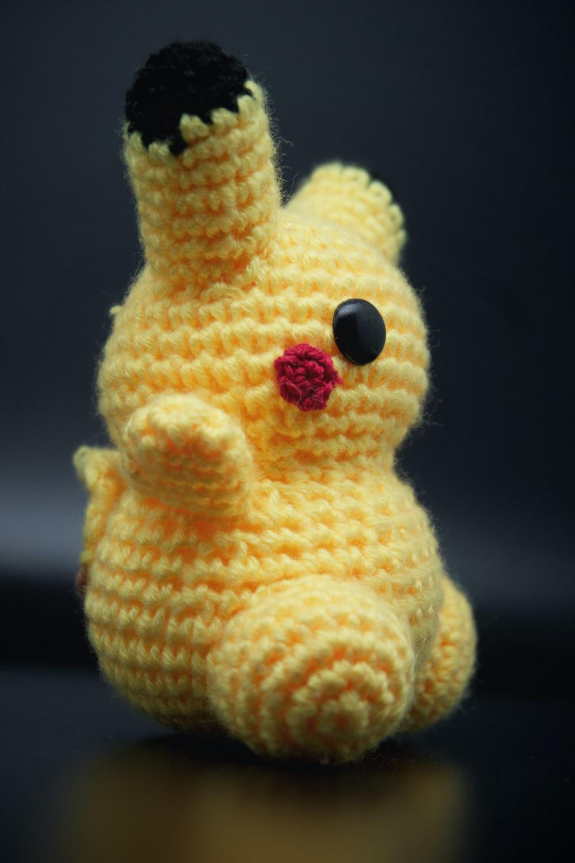 yellow and white bear plush toy