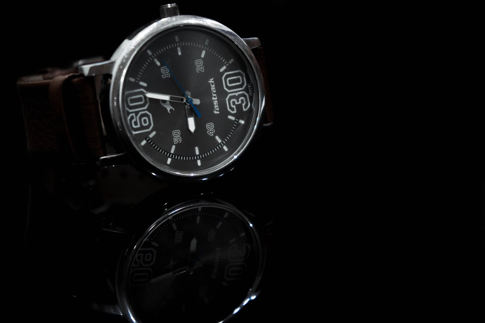 silver and black round analog watch