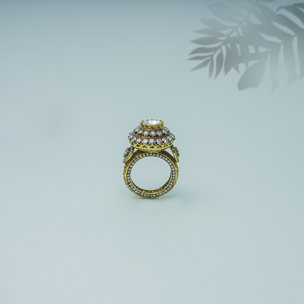 gold ring on white surface