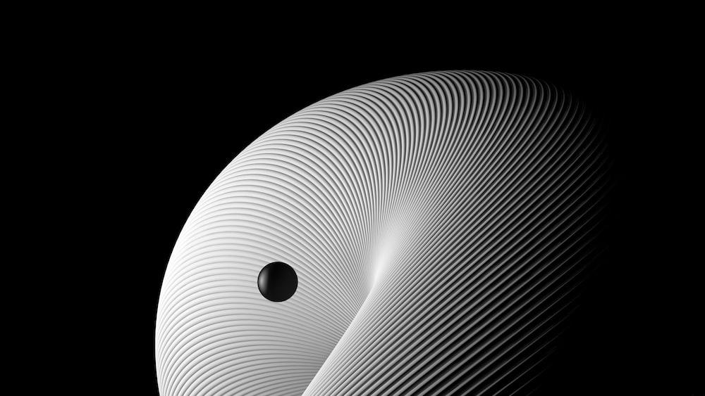 white round light on black background