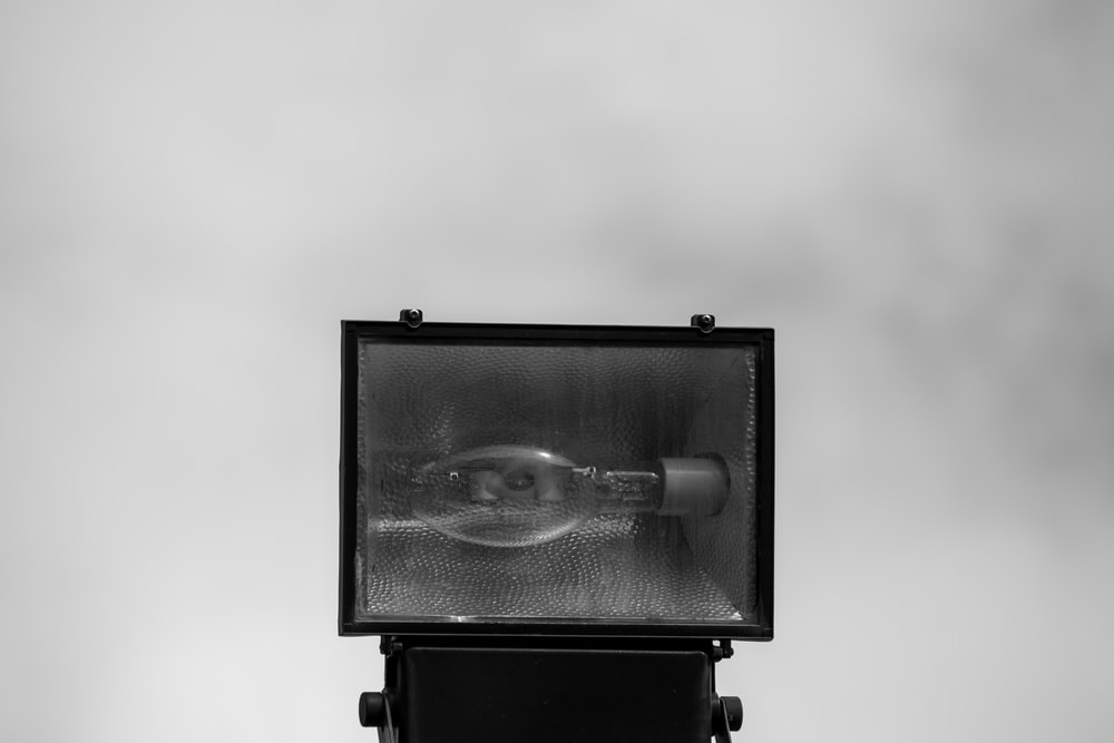 black camera in grayscale photography