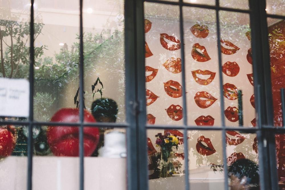 red round fruit on window