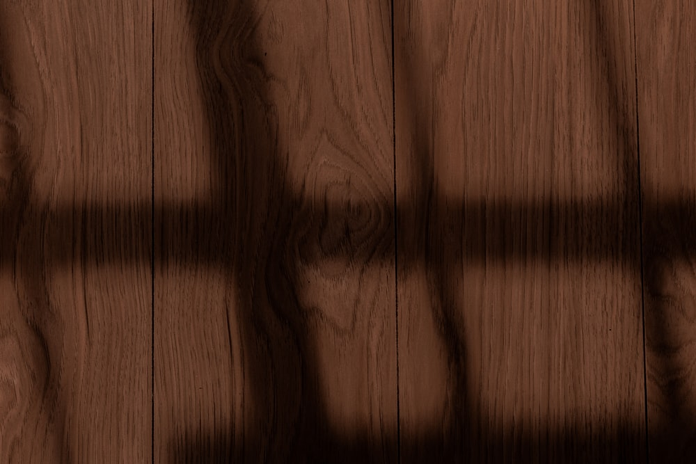 brown wooden surface with black lines