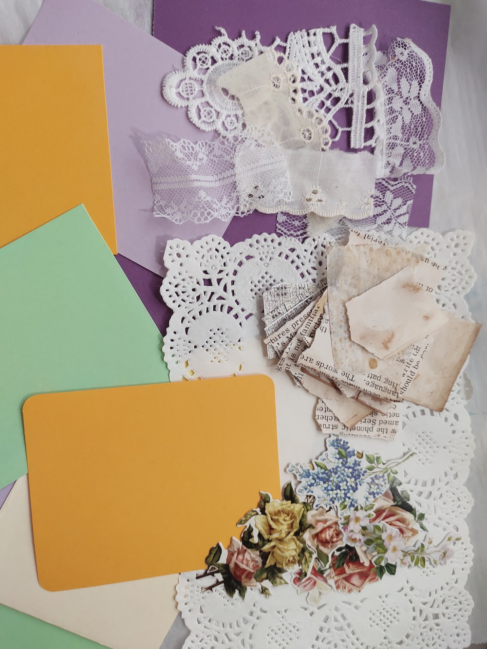 green paper on white floral textile