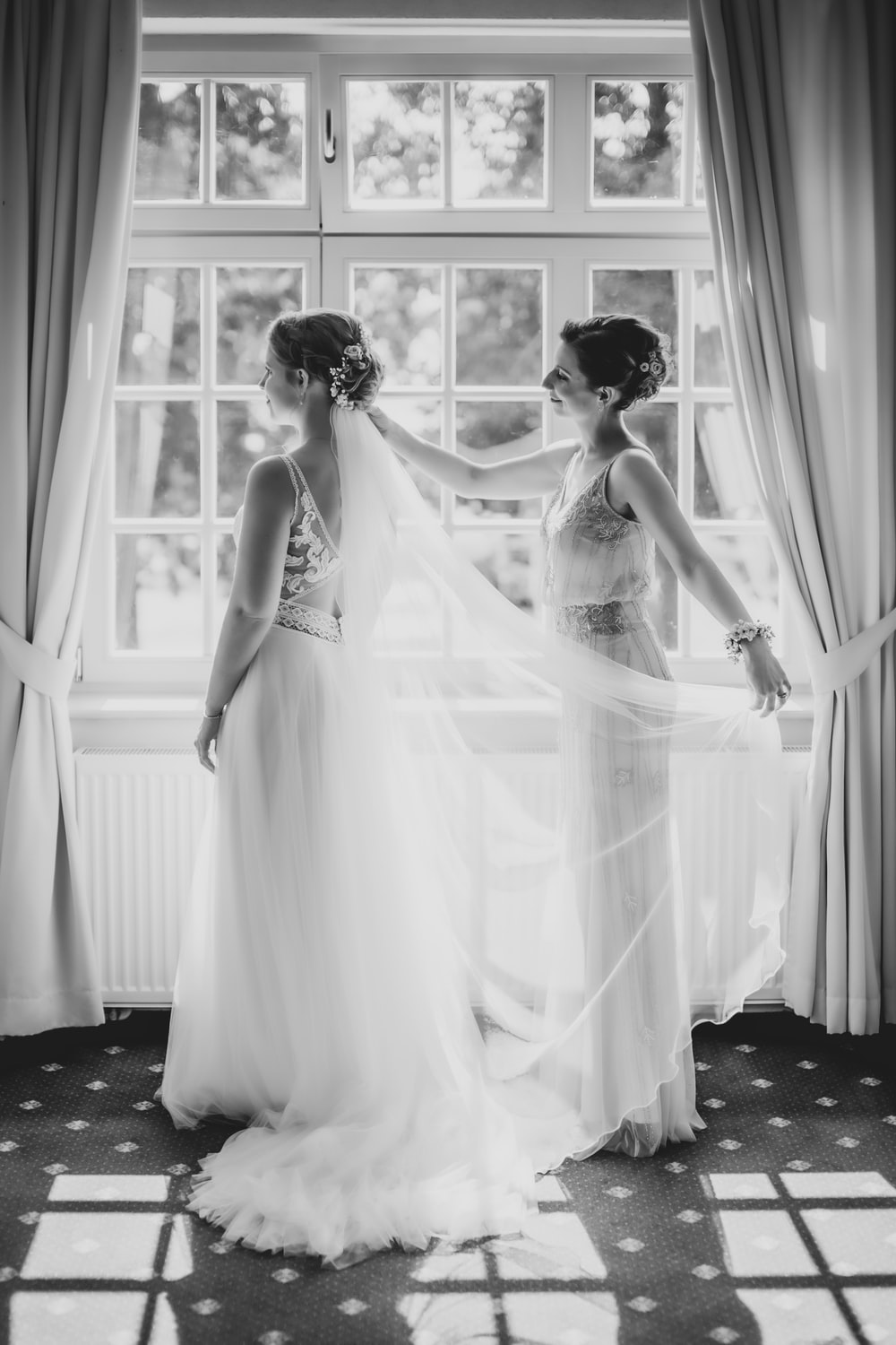 grayscale photo of woman in wedding dress