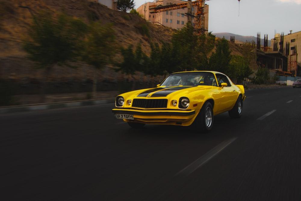 yellow porsche 911 on road during daytime