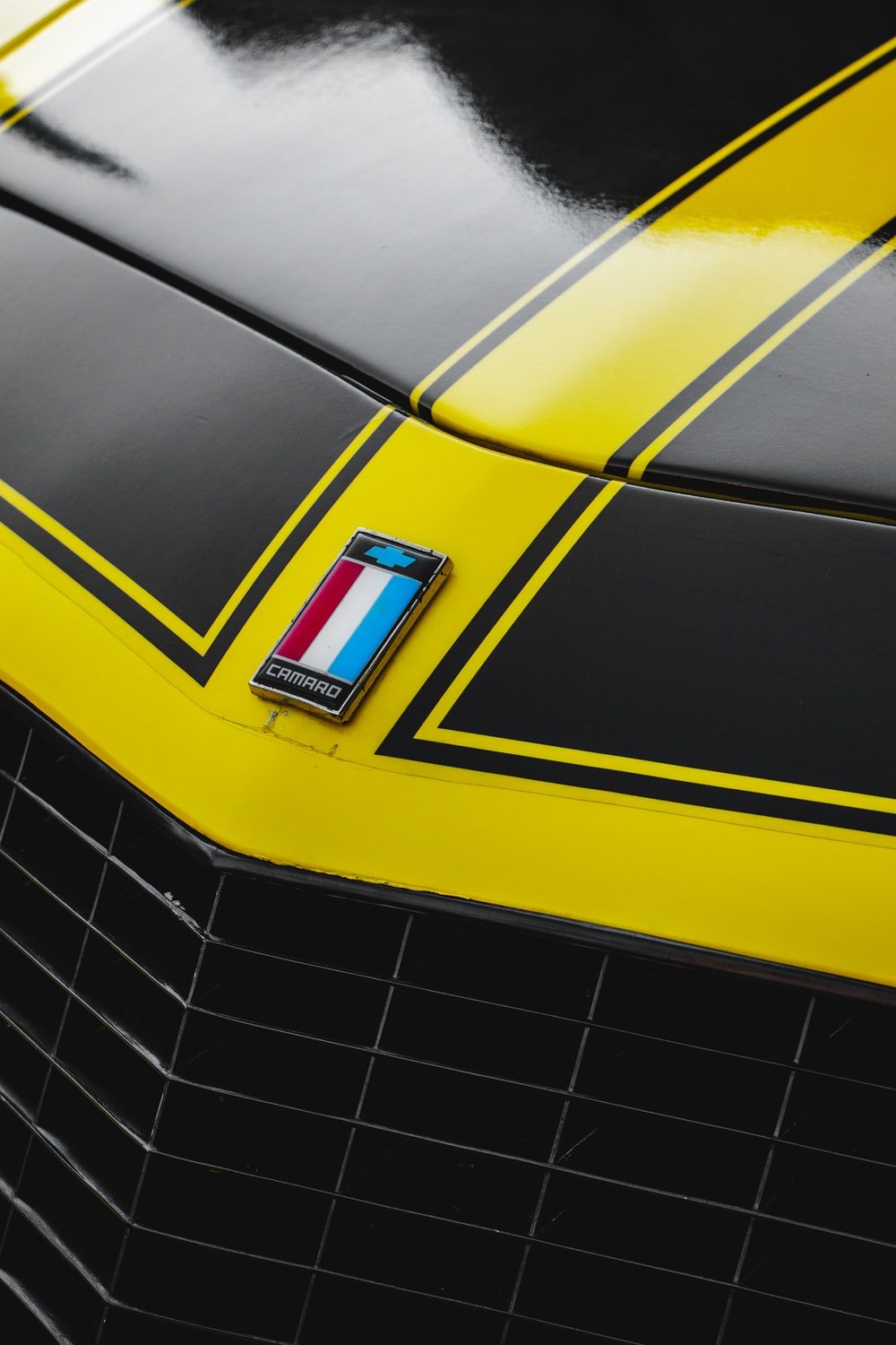 yellow and black car in close up photography