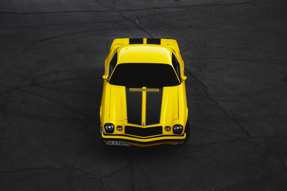 yellow lamborghini aventador on black asphalt road