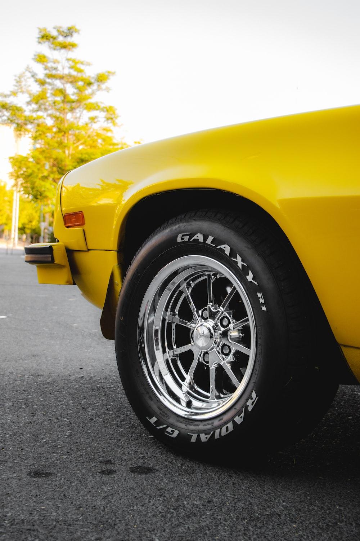 yellow car with black wheel