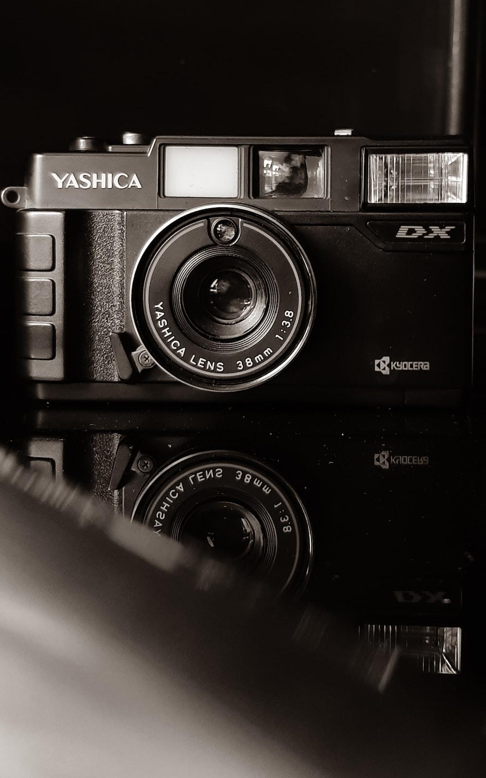 black and silver olympus camera