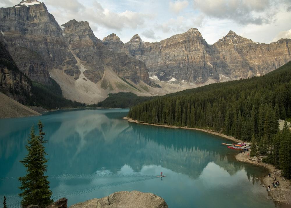 lake near mountain range during daytime