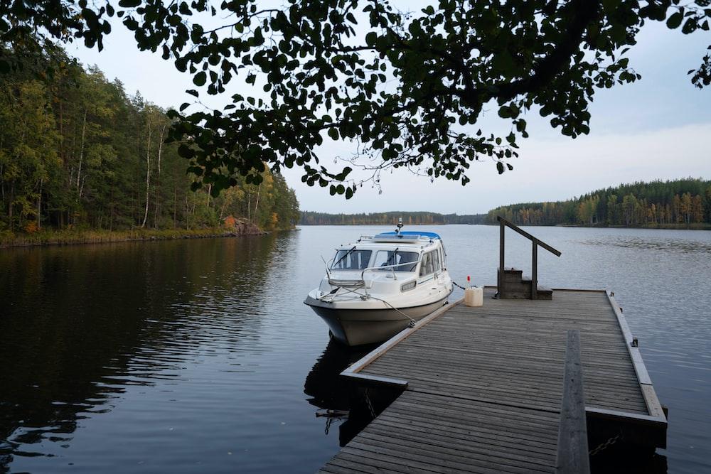 white boat on dock during daytime