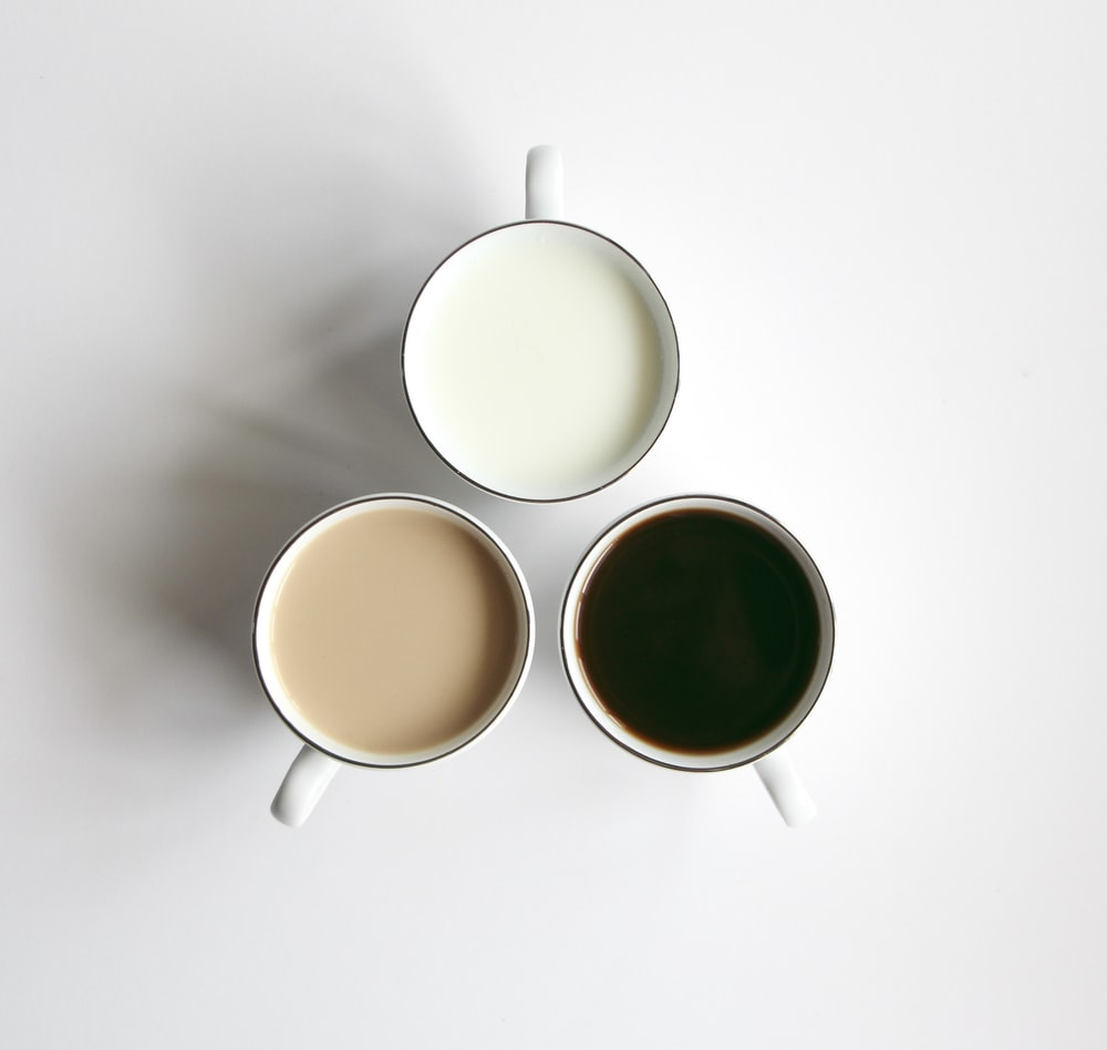 3 white ceramic mugs with brown liquid