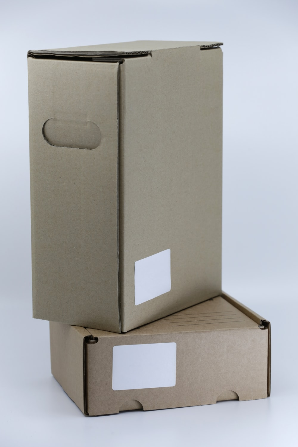 gray cardboard box on white table