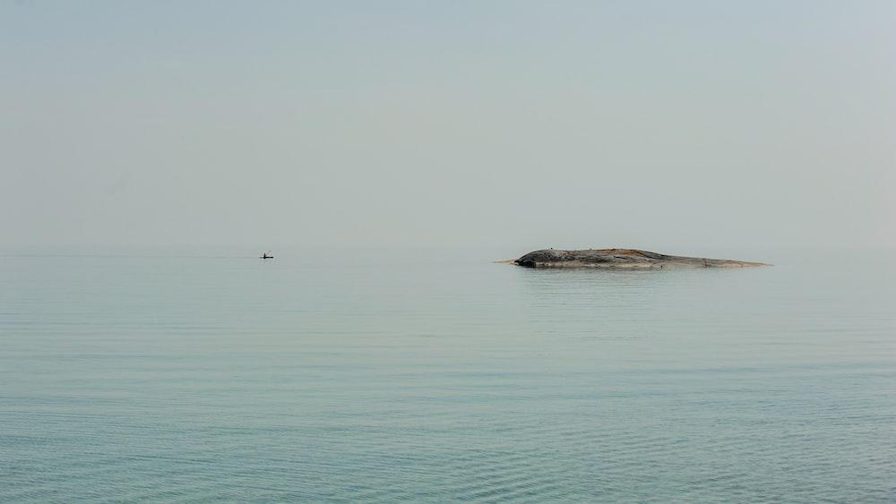 calm sea under foggy weather