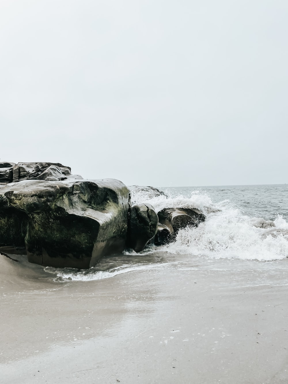 gray rock formation on sea during daytime
