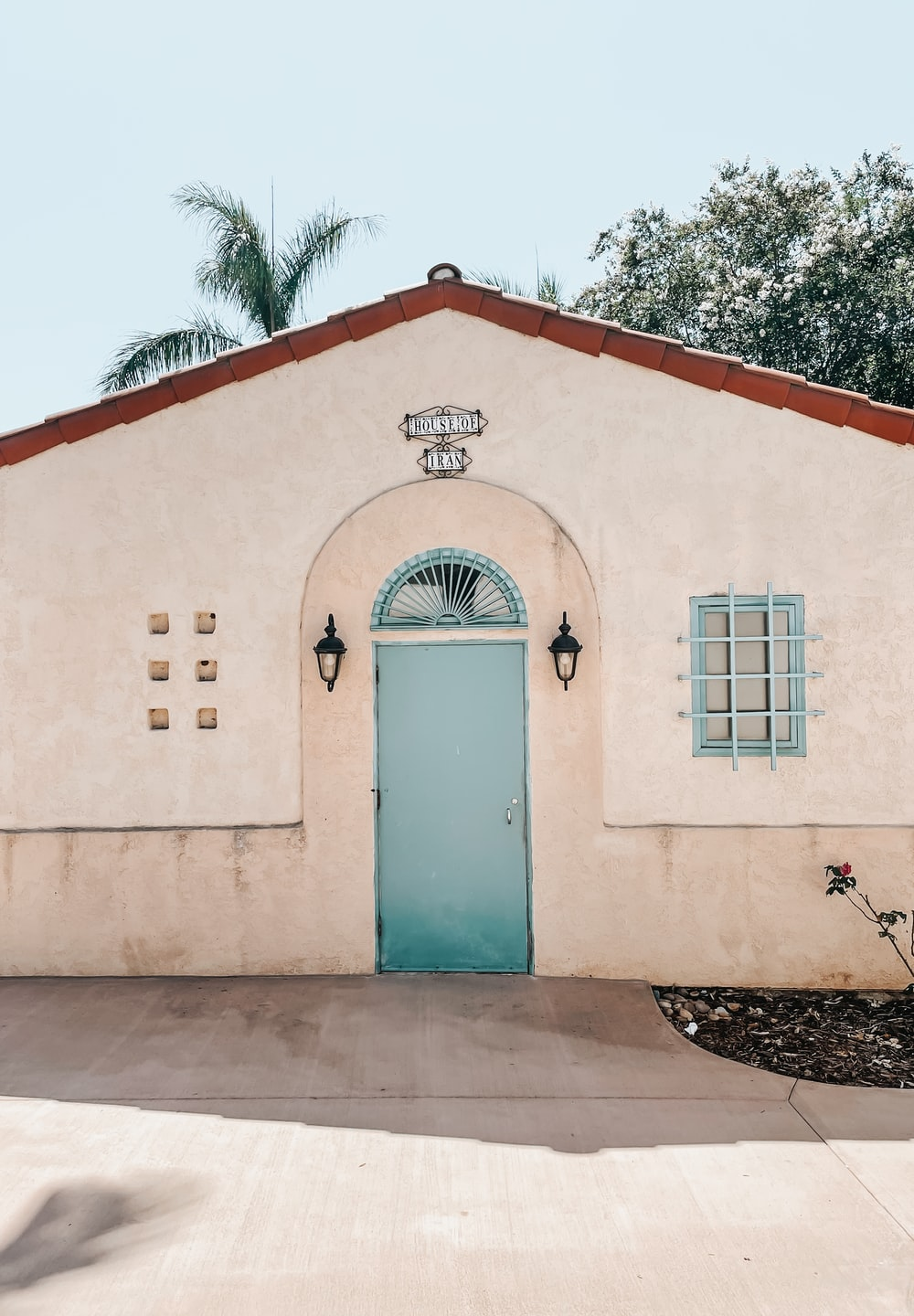 white and teal concrete building