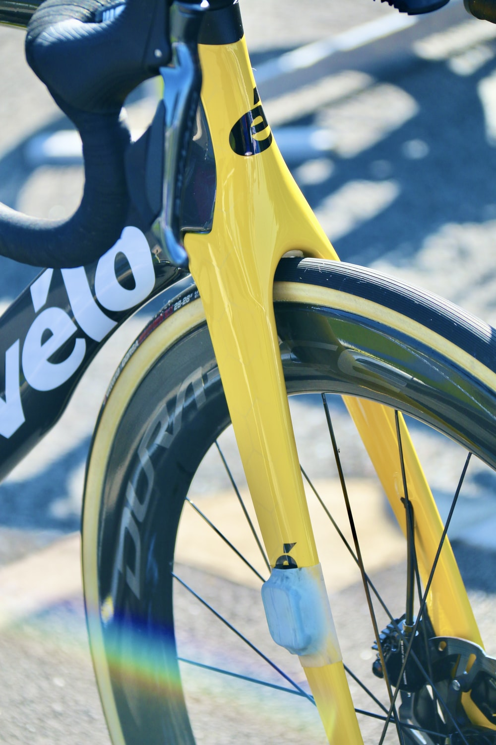 yellow bicycle with black tire