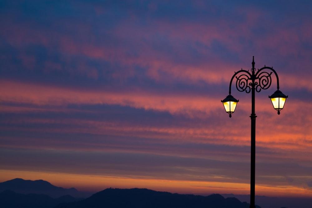 black street light during sunset