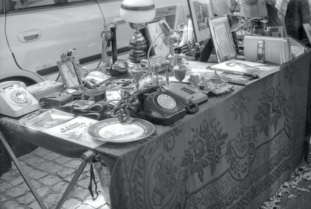 grayscale photo of table with plates and mugs