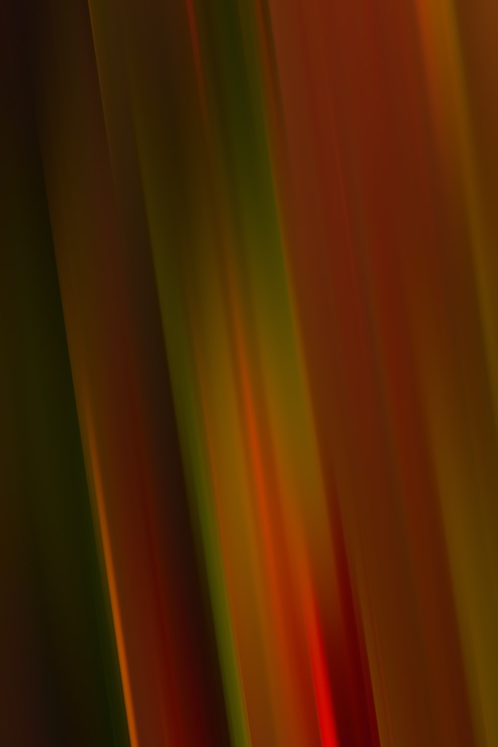 red green and yellow striped textile