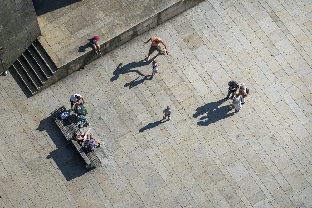people playing basketball on gray concrete pavement during daytime