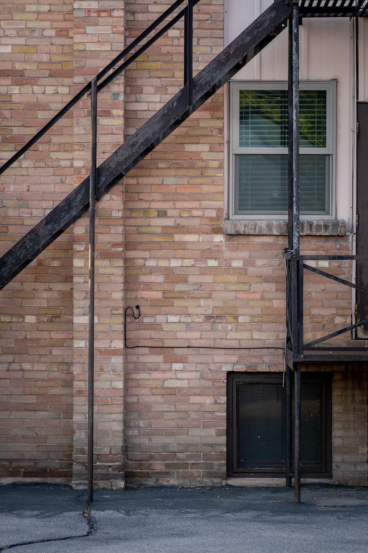 brown brick building with black metal window frame