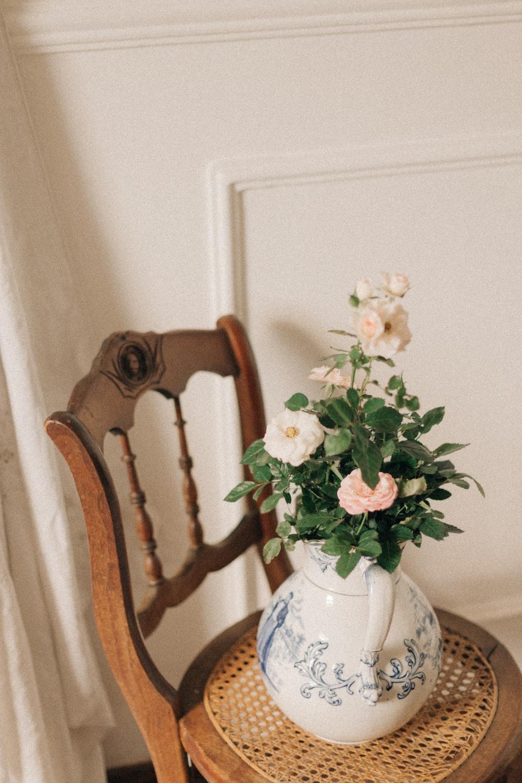 white and pink flower on white ceramic vase