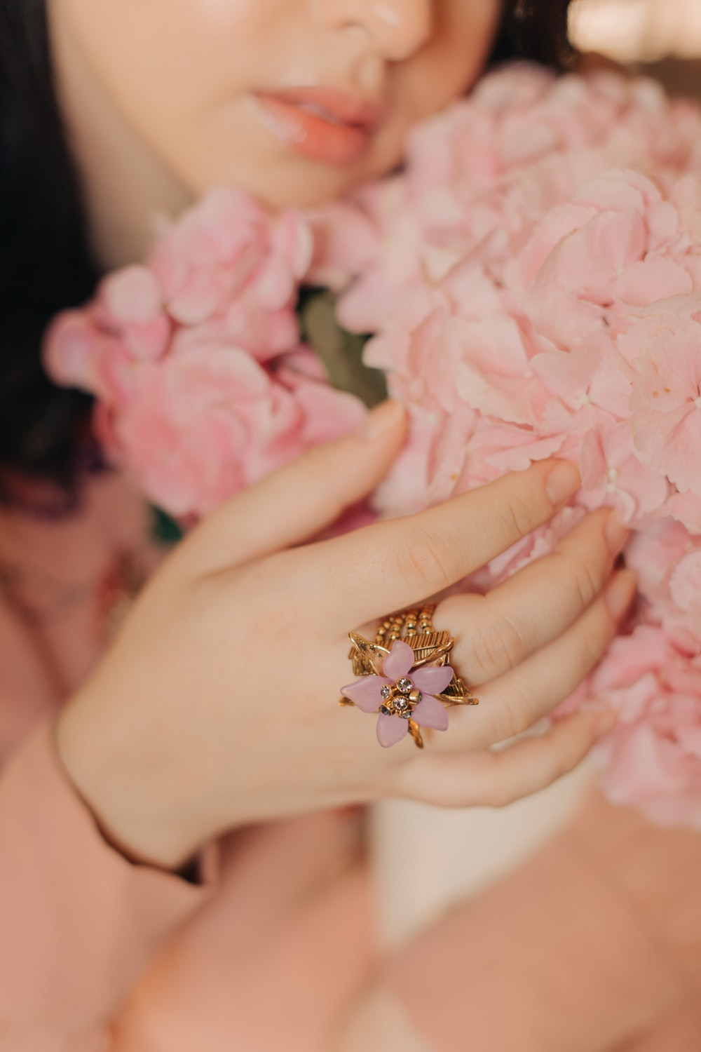gold diamond ring on persons hand