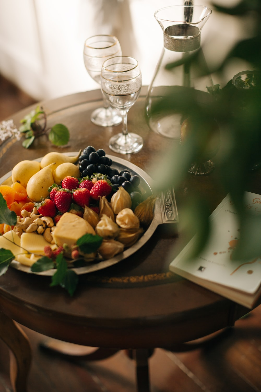 sliced fruits on black ceramic plate