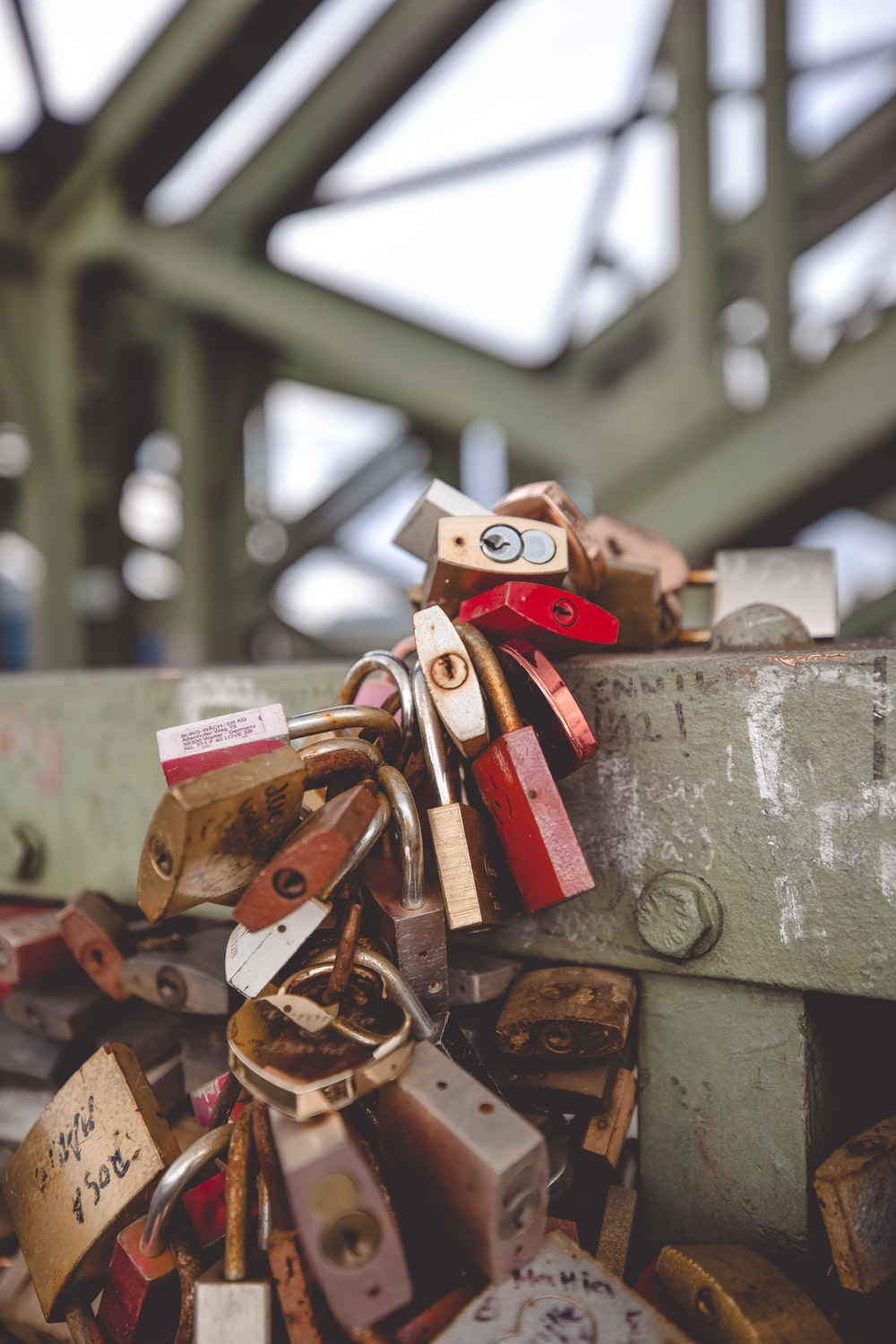 red and gold padlock on grey concrete wall