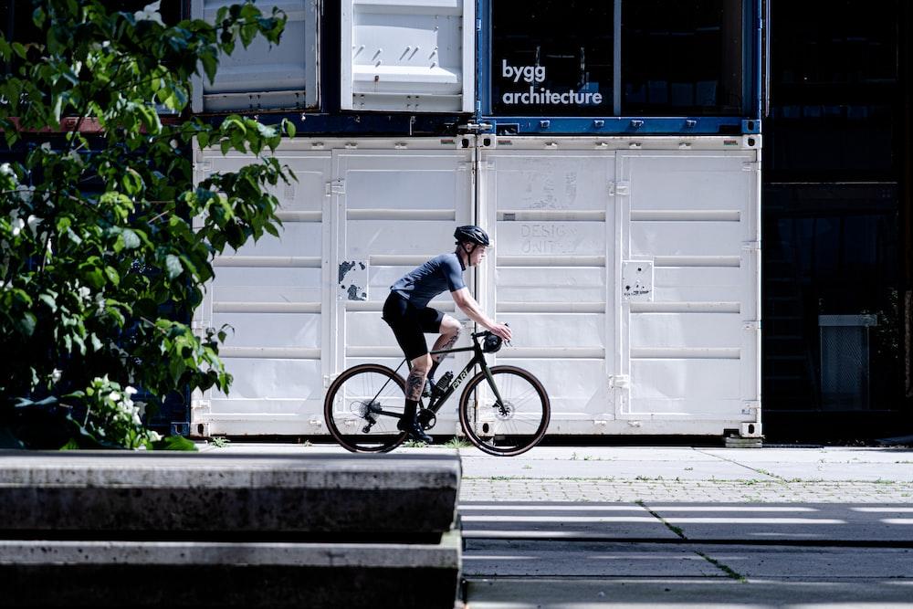 man in black t-shirt riding bicycle during daytime